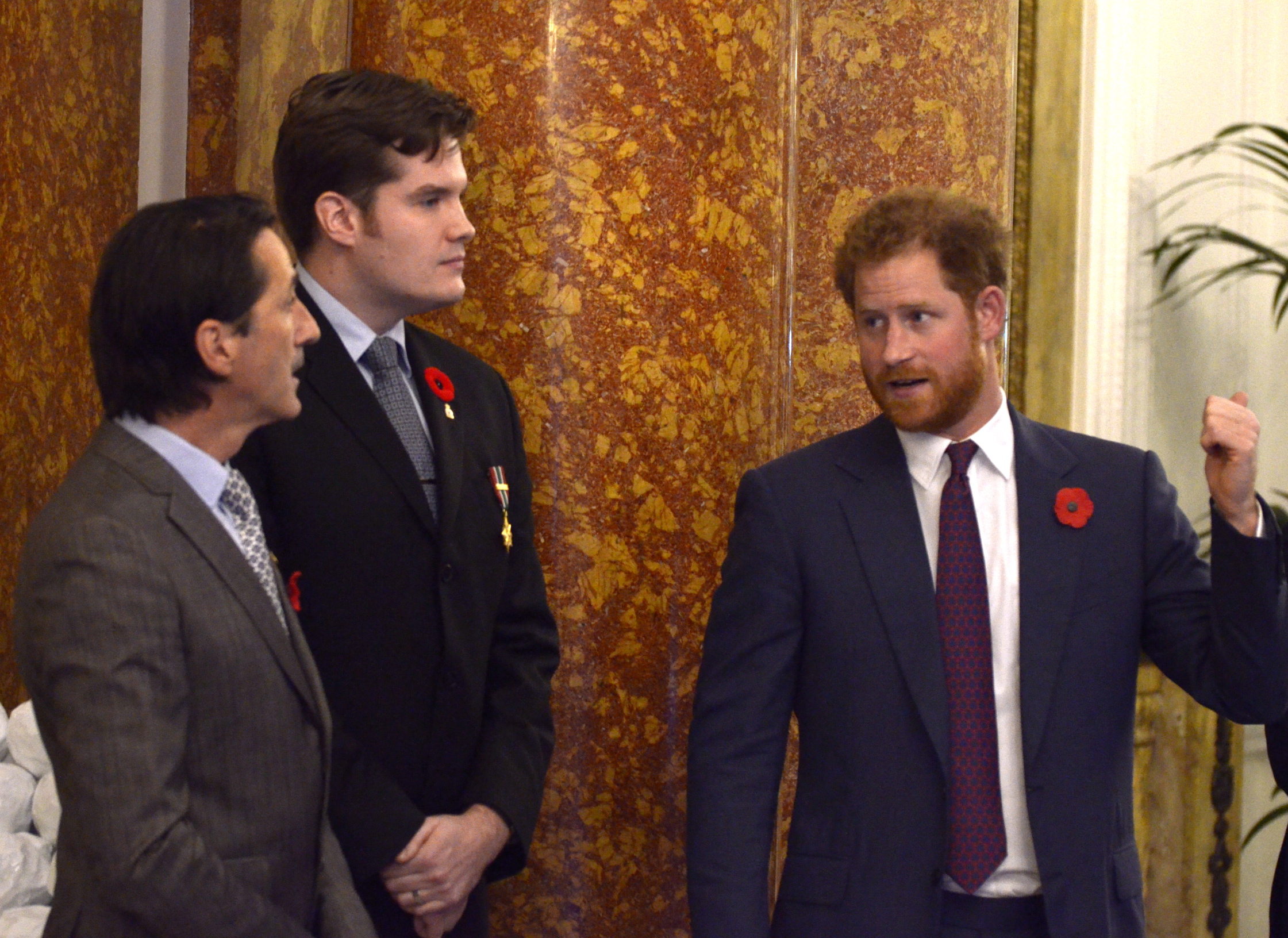 Discussion between Foster and Prince Harry about the images portrayed in the mural